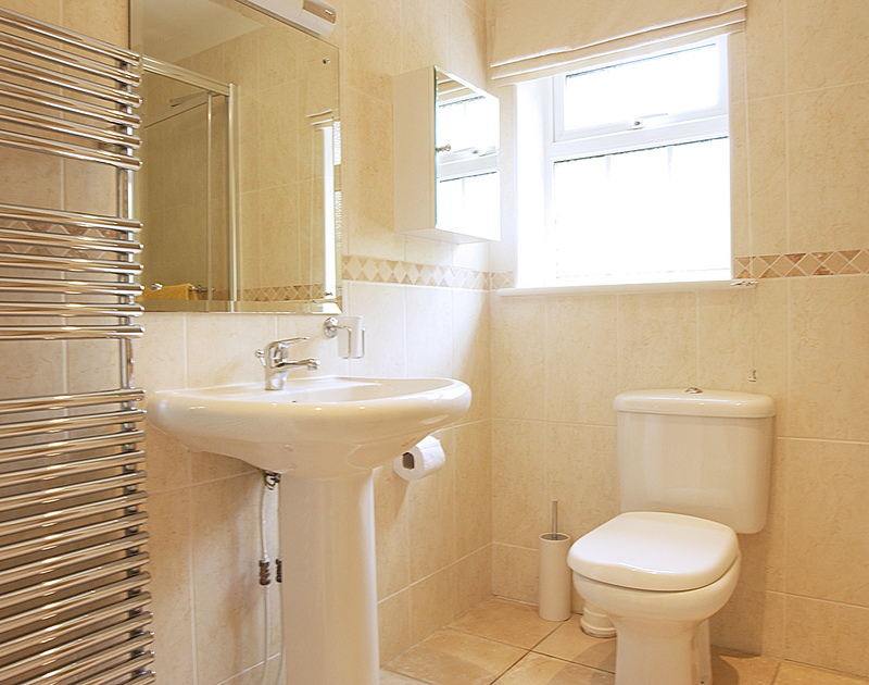 The modern, attractive shower room at Bodare 3, a self-catering holiday apartment to rent at Daymer Bay, Cornwall
