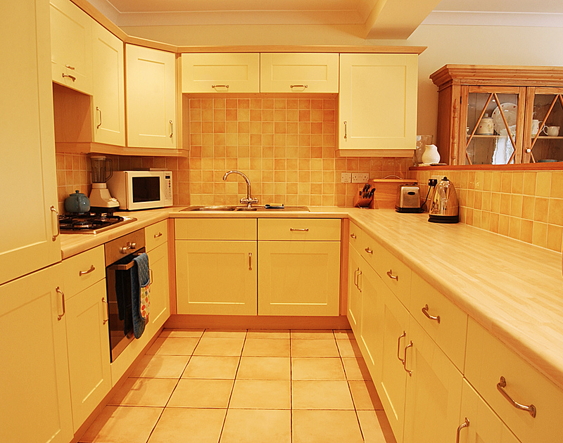 The efficient and practical kitchen of Bodare 3, a holiday apartment to rent at Daymer Bay, Cornwall