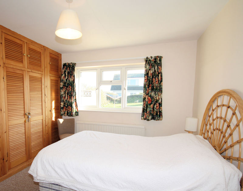 The double bedroom in Badgers Cliff, a holiday rental by the sea in Polzeath, North Cornwall.