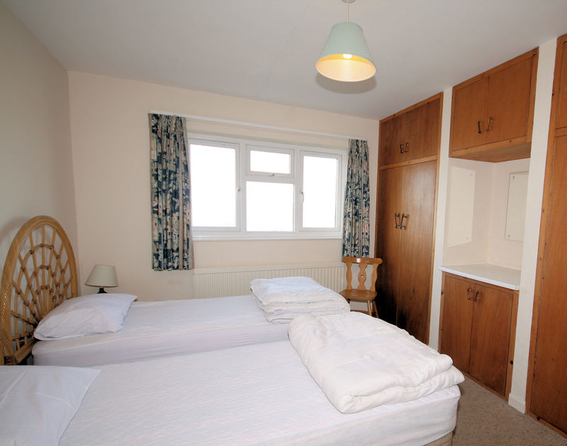 One of two twin bedrooms in Badgers Cliff, a self catering holiday property to rent by the sea in Polzeath, Cornwall.