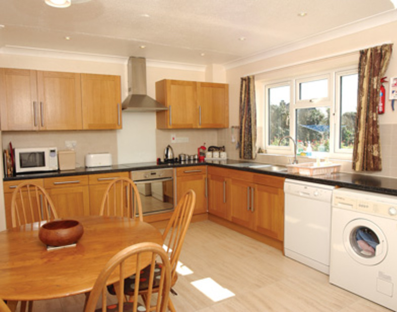 The kitchen and dining room at Badgers Cliff, a self catering holiday bungalow to rent in Polzeath on the North Cornish Coast.