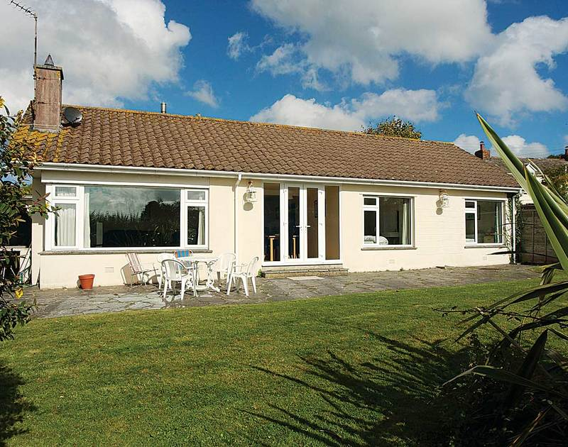 The exterior view and garden of Bedrawle, a self-catering holiday house near the beach in Rock, North Cornwall