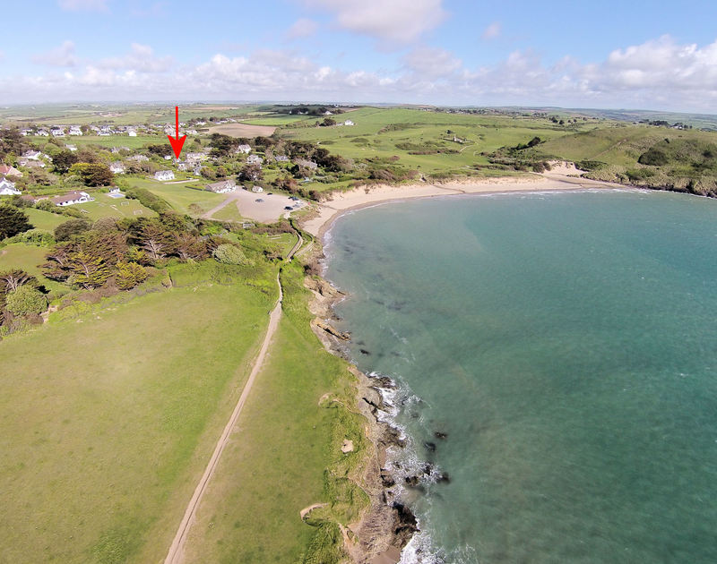An aerial view of the fabulous, beachside location of Little Torquil, a self-catering holiday cottage at Daymer Bay, Cornwall