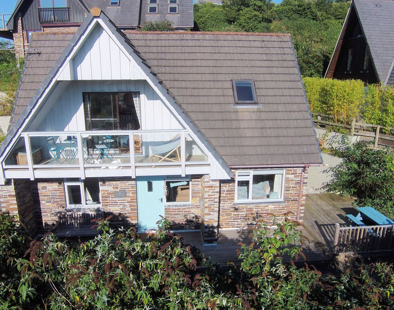 An aerial view of Rocklings, a self-catering holiday house in Rock, Cornwall, with its first floor balcony.