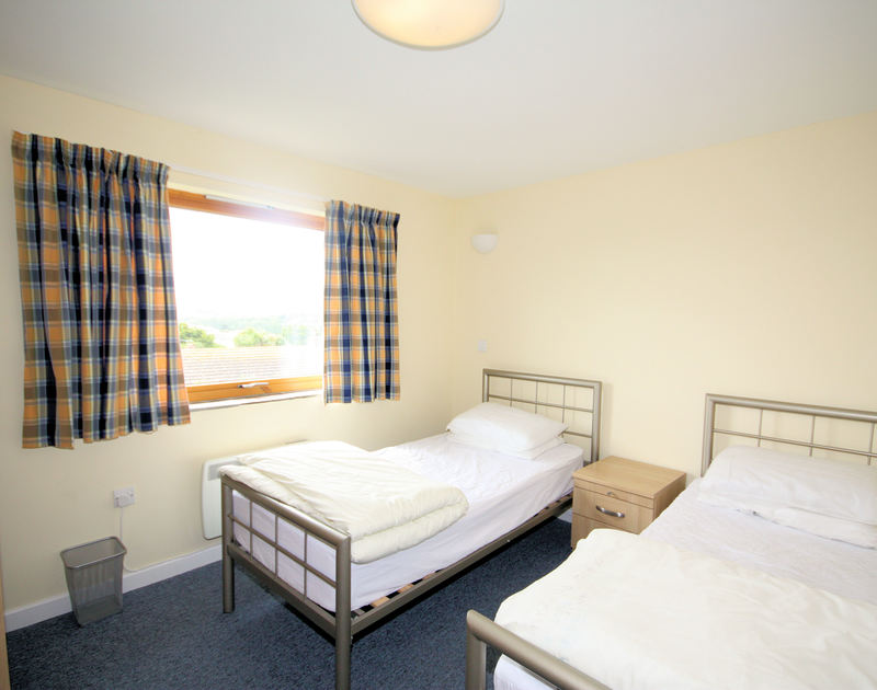 The twin bedroom in Polzeath Court 4,  a self catering holiday apartment to rent in New Polzeath, North Cornwall.