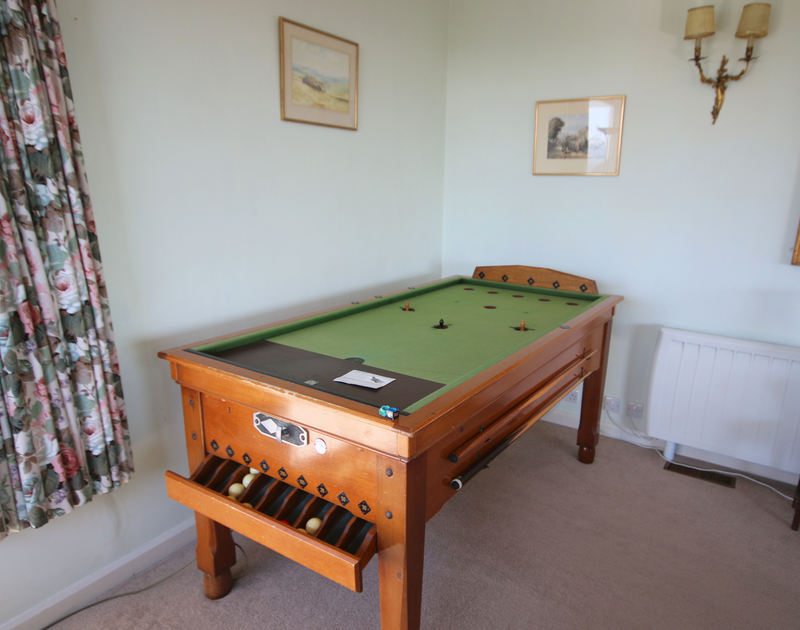 The billiard table in the sitting room of Penrhyn, a holiday house at Daymer Bay, Cornwall