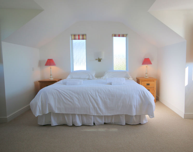 A beautifully proportioned double bedroom at Penrhyn, a holiday rental at Daymer Bay, Cornwall