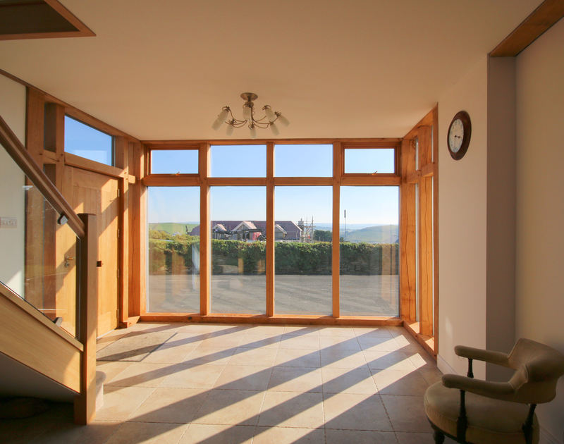 The large, glass-walled lobby of Penrhyn, a holiday house at Daymer Bay, Cornwall