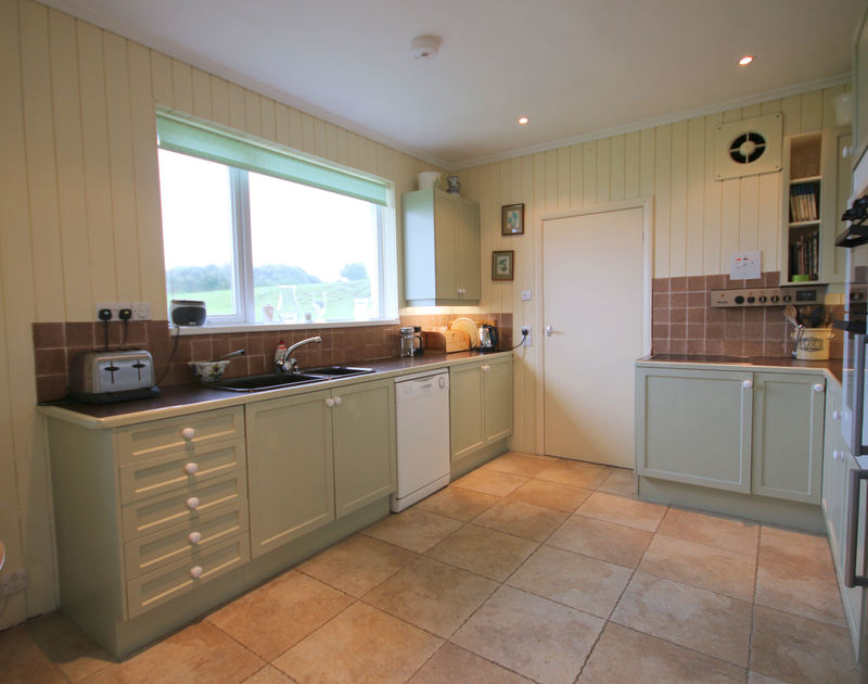 The very attractively styled kitchen of Penrhyn, a holiday house at Daymer Bay, Cornwall