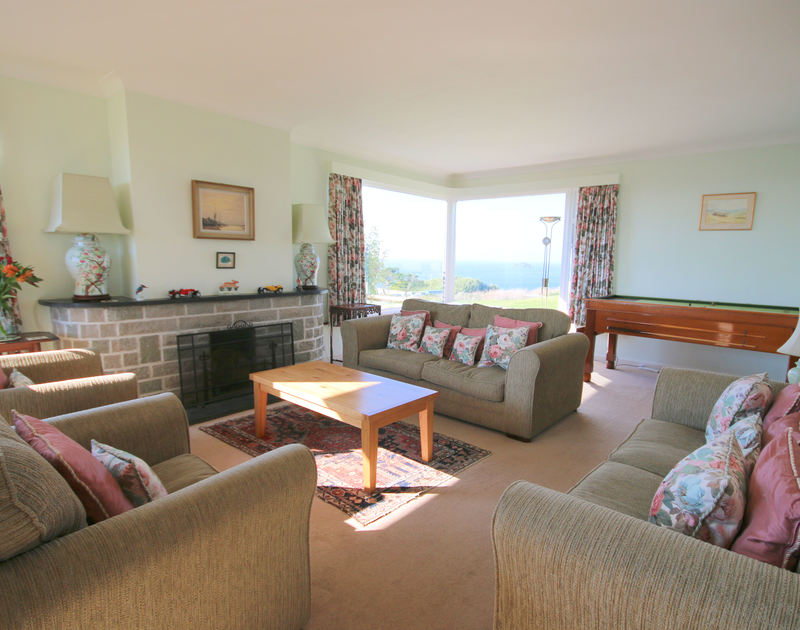 The pretty, comfy sitting room of Penrhyn, a holiday house at Daymer Bay, Cornwall, with tremendous seaviews.