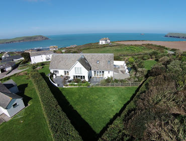 An aerial view of Greenaway Heights, a luxury seaside holiday house near Daymer Bay, Cornwall, with panoramic sea views.