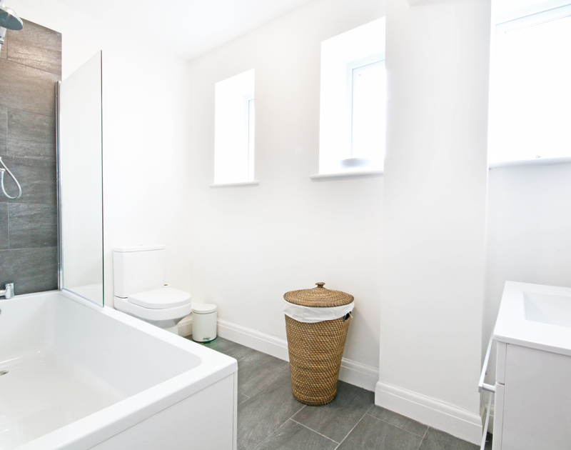 Fresh, light, contemporary bathroom at Flat 1, The Parade, a holiday apartment in Polzeath, Cornwall