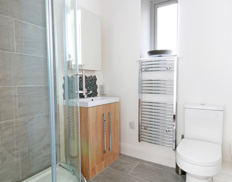 A contemporary shower room at Flat 1, The Parade, a holiday apartment in Polzeath, North Cornwall