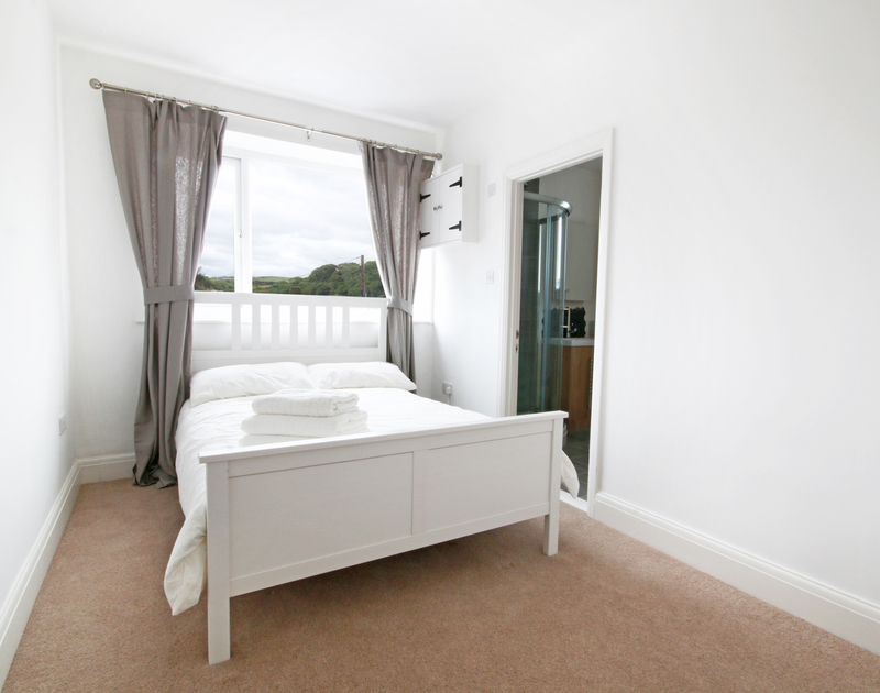 The double bedroom at Flat 1, The Parade, a holiday apartment in Polzeath, Cornwall, with ensuite shower room.