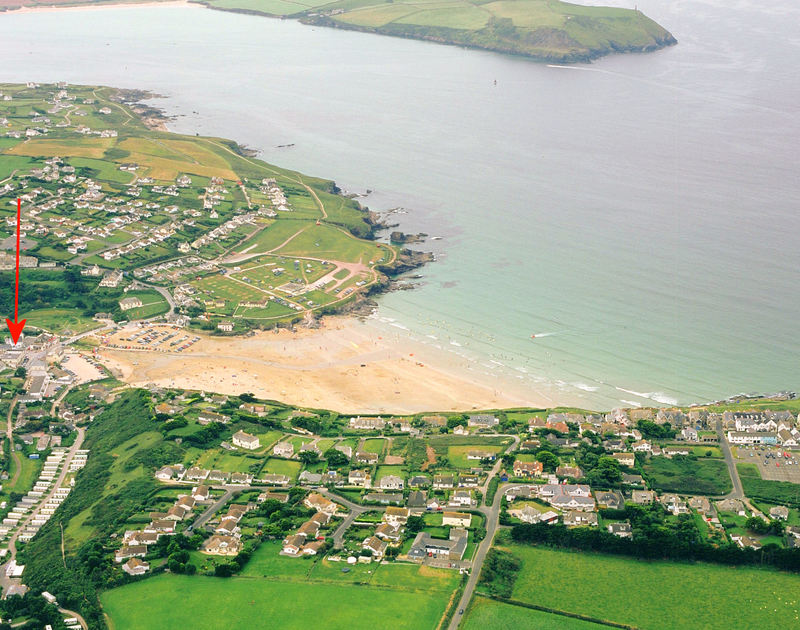 An aerial view of the prime location of Flat 1, The Parade, a holiday apartment opposite the beach at Polzeath, Cornwall
