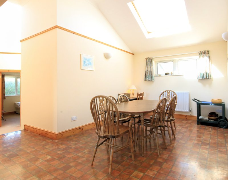 The dining room in Turnstones, a self catering holiday bungalow to rent in Daymer Bay, Cornwall.