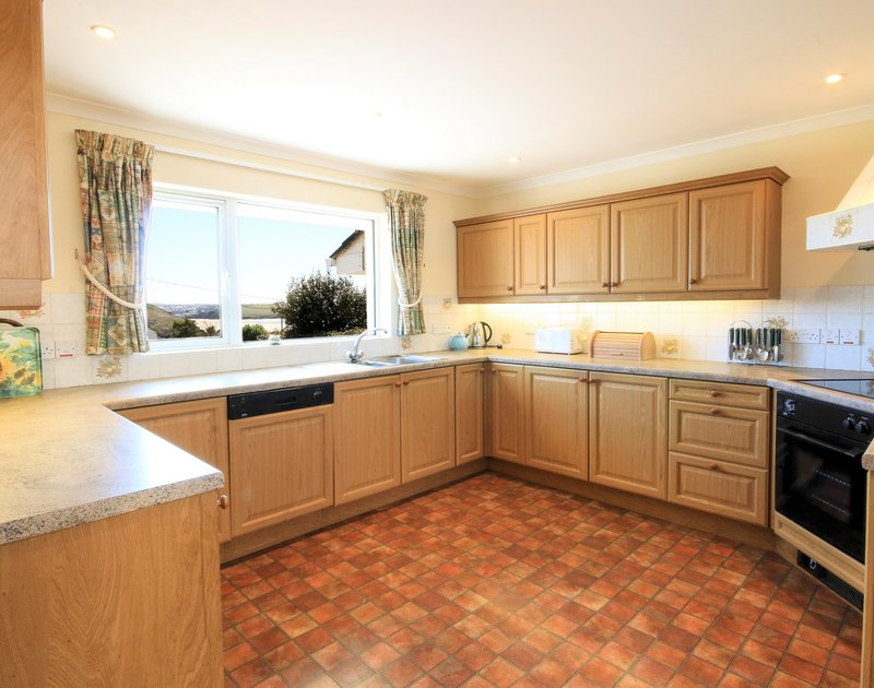 The kitchen with sea views at Turnstones, a self catering holiday house to rent in Daymer Bay, north Cornwall.