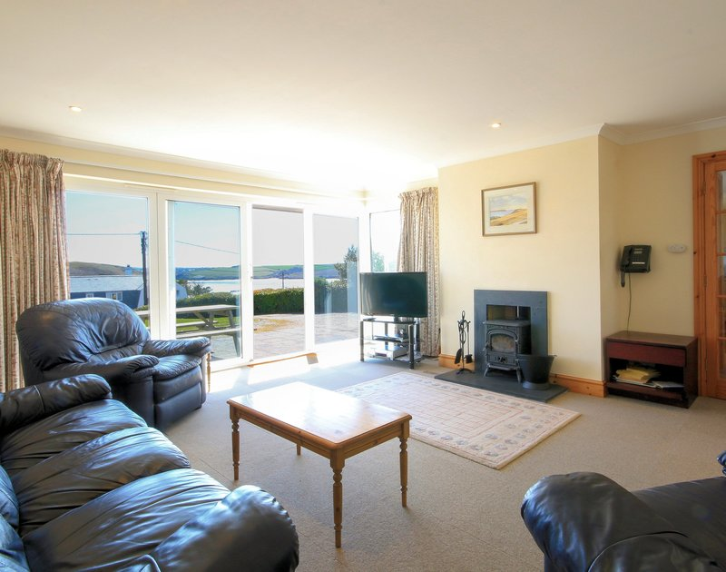 The lounge with Camel Estuary views from Turnstones, a self catering holiday house to rent in Daymer Bay, Cornwall.