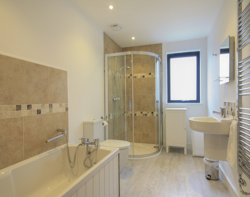 One of four modern bathrooms in The Lighthouse, a luxury self catering holiday house to rent on the Camel Estuary in Rock, Cornwall.