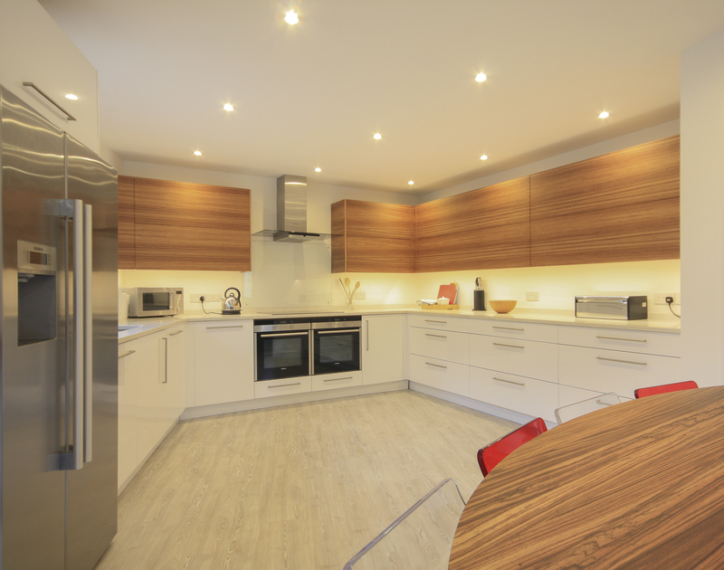 The sleek, contemporary kitchen at The Lighthouse a self catering luxury holiday house to rent in Rock, North Cornwall.