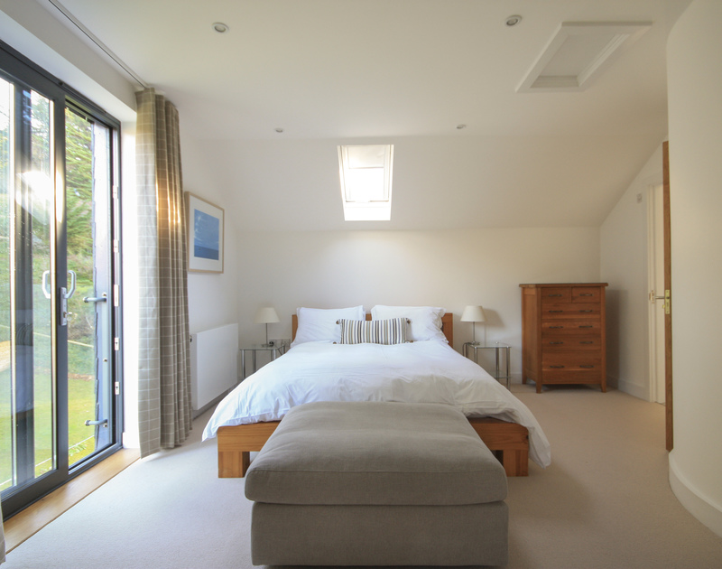 The spacious master bedroom in The Lighthouse, a luxury holiday rental on the Camel Estuary in Rock North Cornwall.