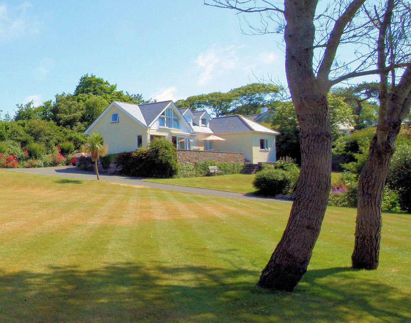 The large mature gardens of Tamarisk, a self-catering holiday house in Rock, Cornwall