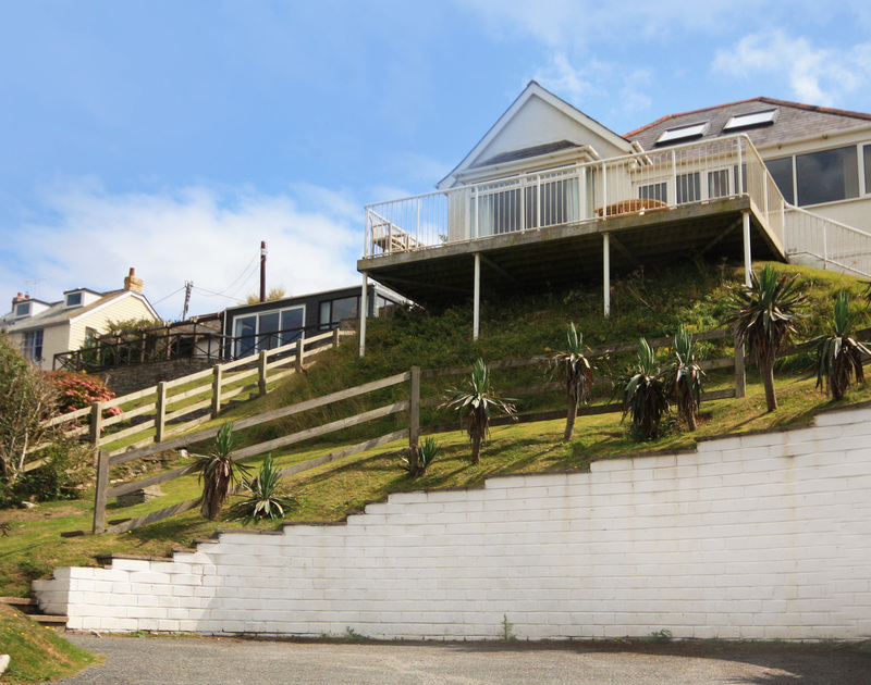 The exterior view and parking area of Seaspray, a holiday house to rent in Polzeath, Cornwall