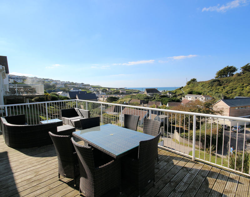 Lovely seaviews from the wooden-decked balcony at Seaspray, a holiday rental in Polzeath, Cornwall