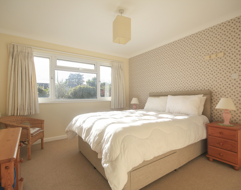 The pretty  master bedroom in Little Sailing, a self catering holiday rental in Rock, North Cornwall.