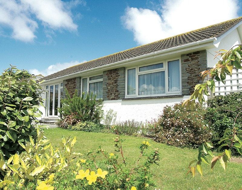 The exterior and the pretty garden at Little Sailing, a self catering holiday rental in Rock, Cornwall.