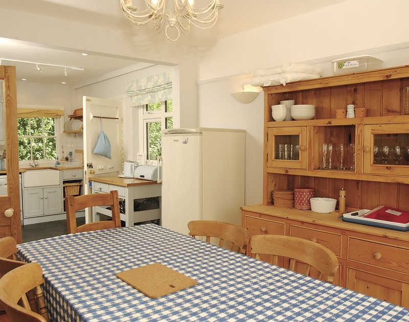 The welcoming kitchen/dining room at Trevian, a family self catering holiday house to rent in Rock, Cornwall.