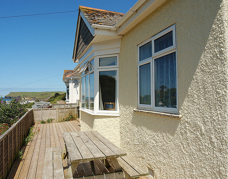The decked terrace with sea views around Burwyn, a self catered holiday house to rent in Polzeath, Cornwall.