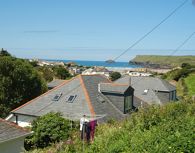 The village, beach and sea views from Burwyn, a self catering holiday house in Polzeath, Cornwall.