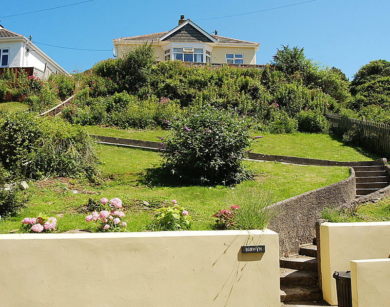 A view of the pretty garden up to the house at Burwyn, a self catering holiday rental in Polzeath, North Cornwall.