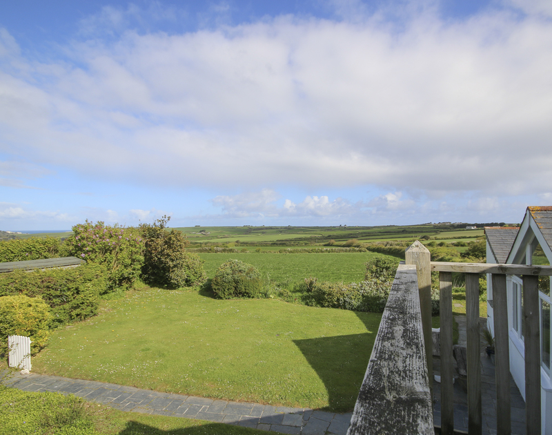 The far reaching rural views from Mencarrek, a pet friendly, self catering holiday rental in St Minver, Rock, Cornwall.
