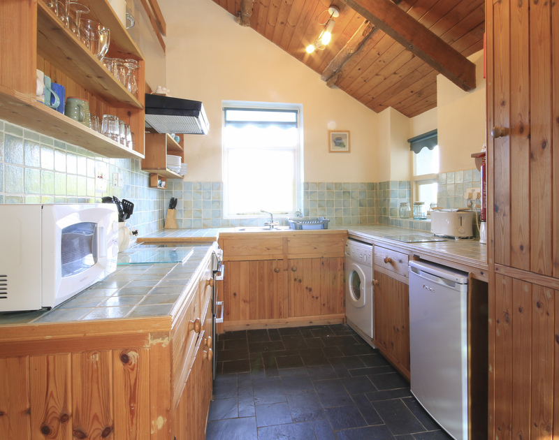 The attractive kitchen in Mencarrek, a self catering holiday rental in St Minver, Rock, Cornwall.