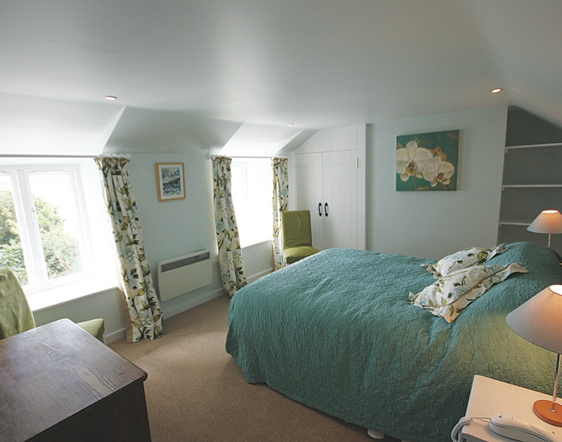A pretty bedroom in Sea Cottage, a self catering holiday cottage just a minutes walk to the beach at Rock in North Cornwall.