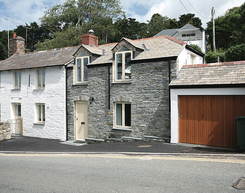 The appealing stone exterior of Sea Cottage, a self catering holiday rental beside the Camel Estuary at Rock in Cornwall.