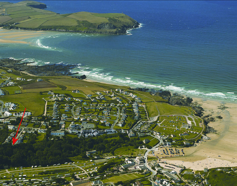 An aerial view showing Penina, a self catering holiday rental in a peaceful setting close to the coast at Polzeath in North Cornwall.
