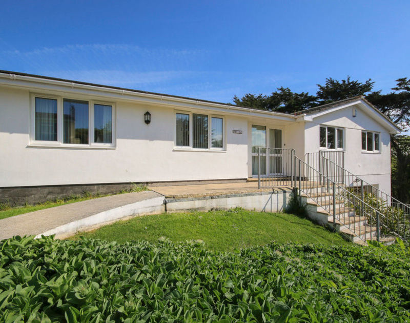 The entrance and the front aspect of Penina, a self catering holiday rental in Polzeath, Cornwall.