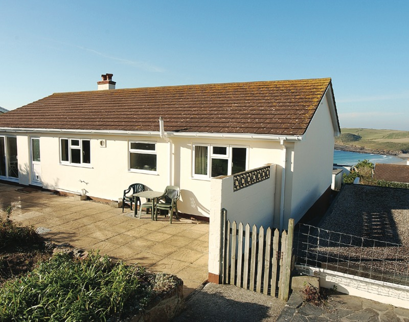 The terrace around Badgers Cliff with the wonderful sea views beyond, available for holiday rental in Polzeath, North Cornwall.