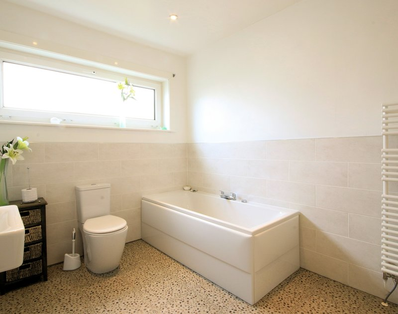 The smart, contemporary ensuite bathroom at Balderstone, a holiday house in Polzeath, Cornwall