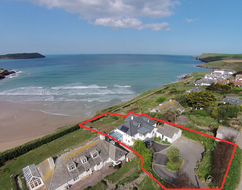 An aerial view of majestic holiday house Treverden, set in large gardens on the cliff top at New Polzeath, North Cornwall.