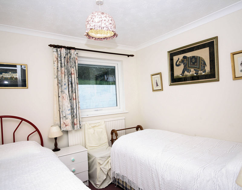 One of 3 twin bedrooms at Stradav, a self-catering holiday house to rent in Polzeath, Cornwall