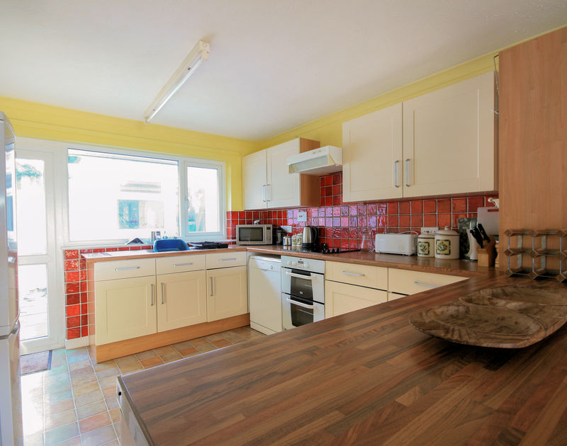 The well-equipped kitchen of Stradav, a self-catering holiday house in Polzeath, Cornwall