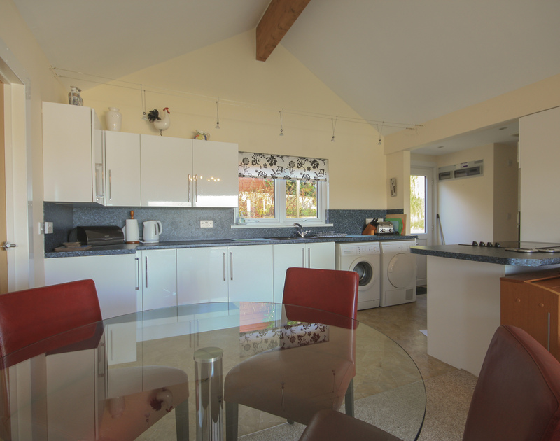 The kitchen and dining area in Dozmary, a self catering holiday house to rent in Polzeath, Cornwall.