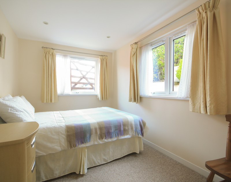 A light double bedroom in Dozmary, a self catering holiday house to rent in Polzeath, Cornwall.