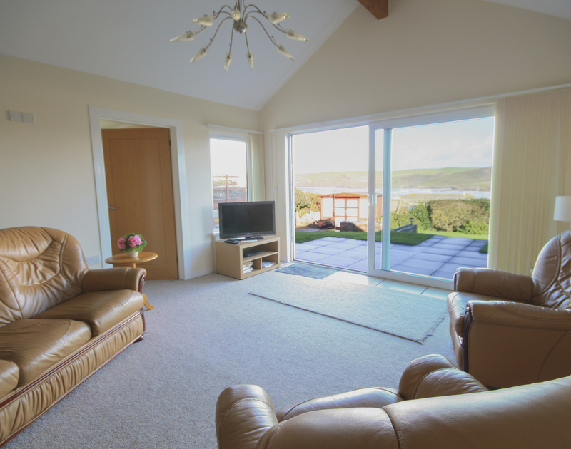 The sitting room with fantastic sea views from Dozmary, a self catering holiday house to rent in Polzeath, North Cornwall.