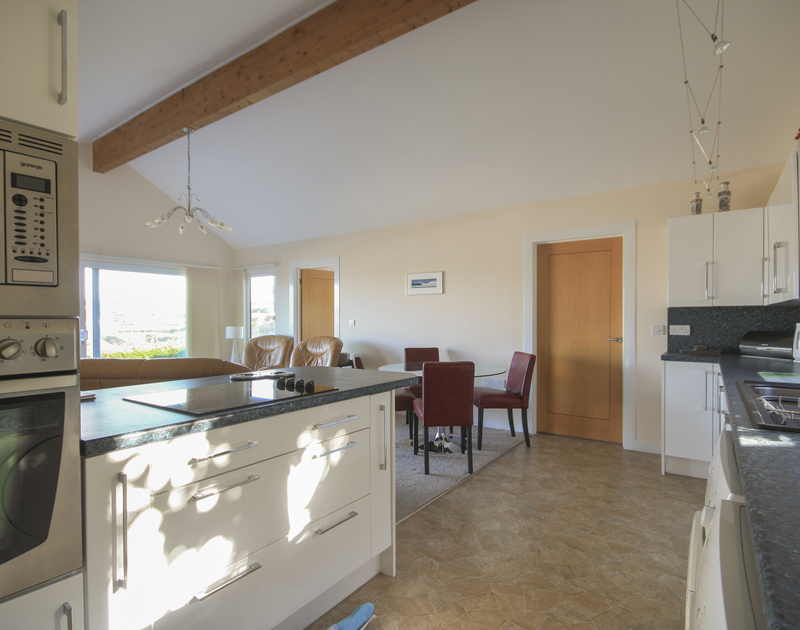 The open plan living areas at Dozmary, an  ideally situated seaside holiday rental in Polzeath, Cornwall.