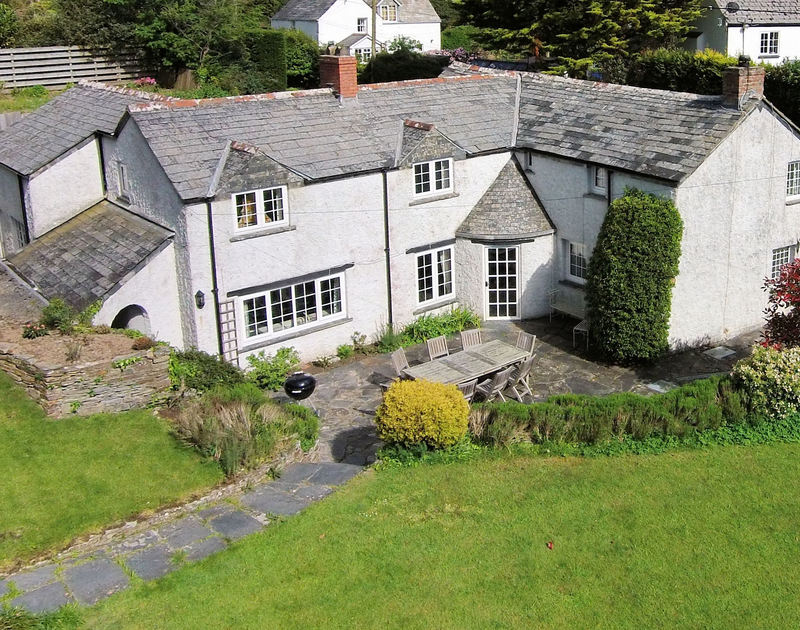 An aerial view of picturesque Peppercorn Cottage, a self catering holiday rental in very pretty gardens in Rock, Cornwall.